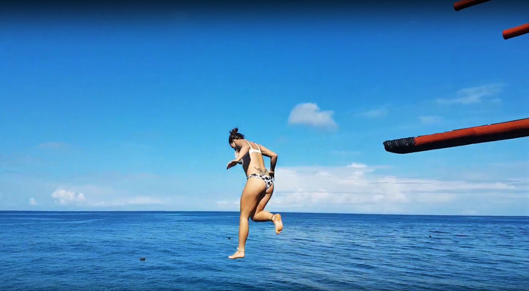 cliffjumping girl ocean